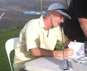 Trev signing closeup smiling